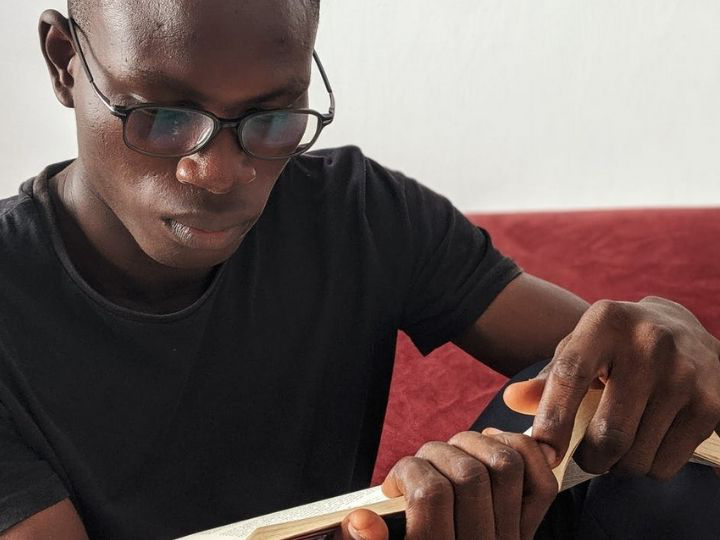 Man with glasses reading a book